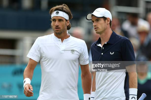 Andy Murray of Great Britain speaks with playing partner Feliciano Lopez of Spain during his First Round Doubles match against Juan Sebastian Cabal...