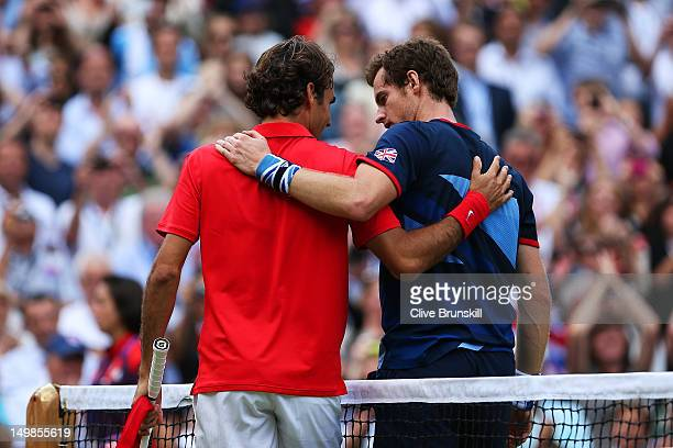 Andy Murray of Great Britain speaks with Roger Federer of Switzerland at the net after the Men's Singles Tennis Gold Medal Match on Day 9 of the...