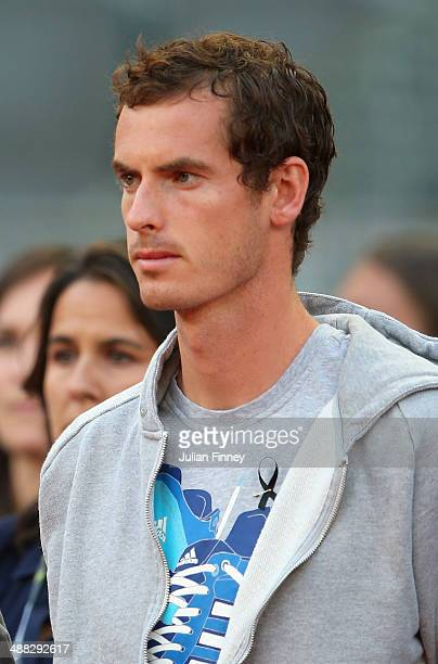 Andy Murray of Great Britain stands for a minutes silence after the news of former tennis player Elena Baltacha who died of liver cancer during day...