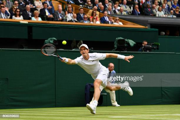 Andy Murray of Great Britain stretches as he plays a forehand during the Gentlemen's Singles first round match against Alexander Bublik of Kazakhstan...
