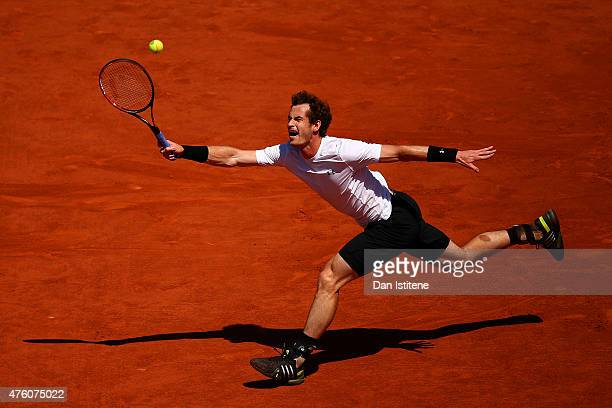 Andy Murray of Great Britain stretches for a forehand in his Men's Semi Final match against Novak Djokovic of Serbia on day fourteen of the 2015...