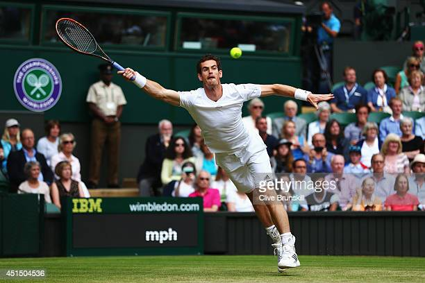 Andy Murray of Great Britain stretches for a return during his Gentlemen's Singles fourth round match against Kevin Anderson of South Africa on day...