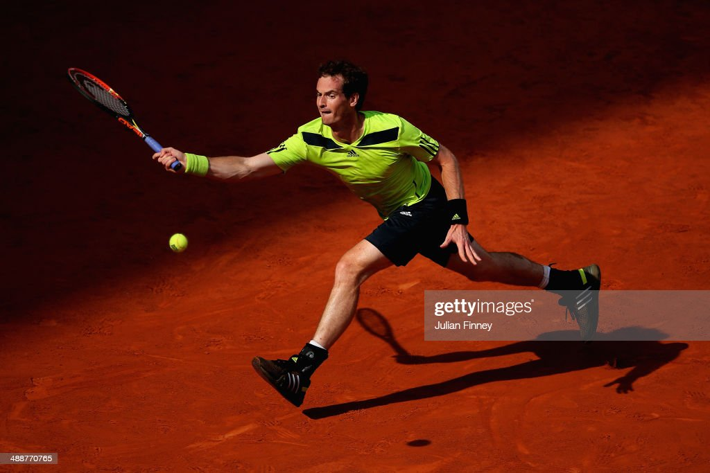 Andy Murray of Great Britain stretches for a shot in his match against Santiago Giraldo of Colombia during day six of the Mutua Madrid Open tennis tournament at the Caja Magica on May 8, 2014 in Madrid, Spain.