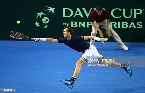 Andy Murray of Great Britain stretches for the ball during Day Three of the Davis Cup Semi Final match between Great Britain and Australia at...