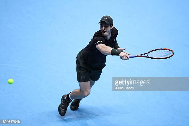 Andy Murray of Great Britain stretches to hit a backhand during the Singles Final against Novak Djokovic of Serbia at the O2 Arena on November 20...