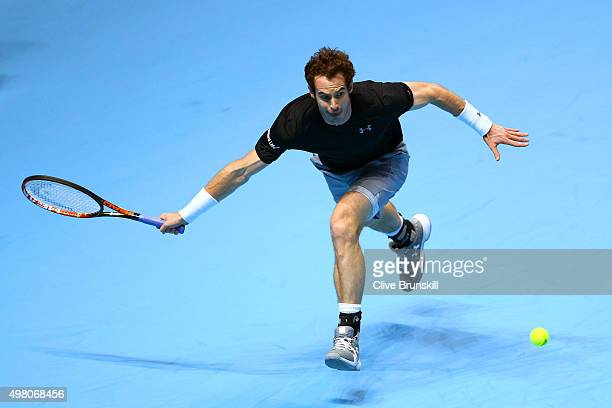 Andy Murray of Great Britain stretches to hit a forehand during the men's singles match against Stan Wawrinka of Switzerland on day six of the...