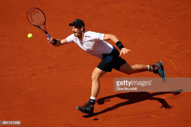 Andy Murray of Great Britain stretches to hit a forehand during the men's singles semi final match against Stan Wawrinka of Switzerland on day...