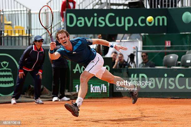 Andy Murray of Great Britain stretches to play a forehand against Andreas Seppi of Italy during day two of the Davis Cup World Group Quarter Final...