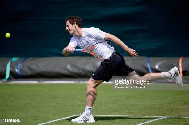 Andy Murray of Great Britain stretches to play a forehand in his training session on Middle Sunday at Wimbledon on June 30 2013 in London England