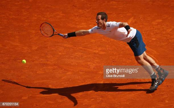 Andy Murray of Great Britain stretches to return a serve against Gilles Muller of Luxembourg in his second round match on day four of the Monte Carlo...