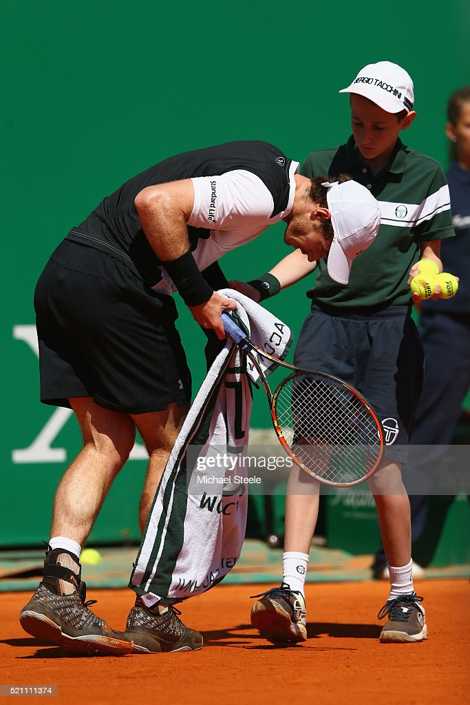 Andy Murray of Great Britain stumbles over the feet of a ball boy during his match against Benoit Paire of France during day five of the Monte Carlo Rolex Masters at Monte-Carlo Sporting Club on April 14, 2016 in Monte-Carlo, Monaco.