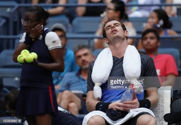 TOPSHOT Andy Murray of Great Britain takes a break while playing Fernando Verdasco of Spain during Day 3 of the 2018 US Open Men's Singles match at...