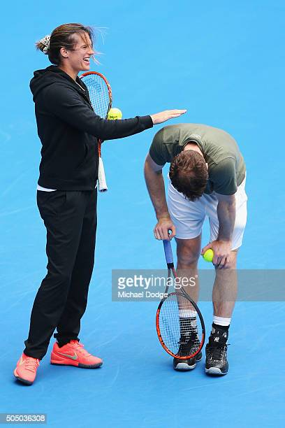 Andy Murray of Great Britain takes a moment to pause after his coach Amelie Mauresmo patting him threw a ball and hit him during a practice session...