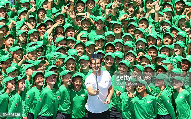 Andy Murray of Great Britain takes a selfie with ballkids from Australia and overseas during the annual ballkid team photo ahead of the 2016...