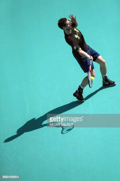 Andy Murray of Great Britain takes part in a tennis practice session in Abu Dhabi prior to heading to compete in the Australian Open in January, on...