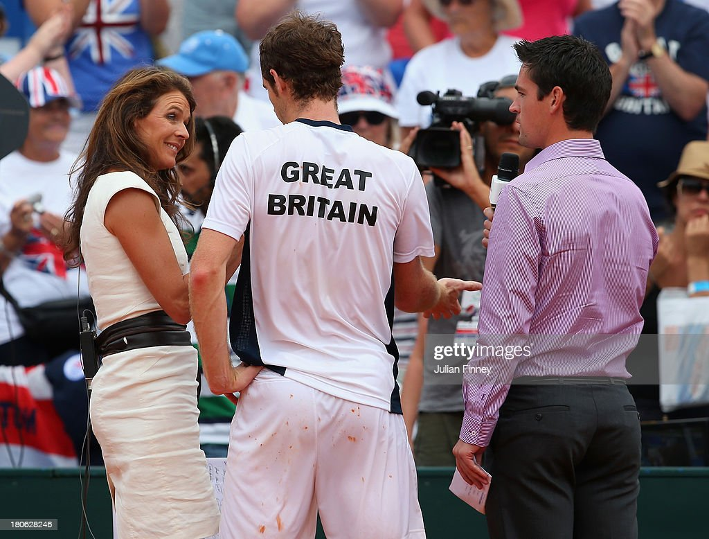 Andy Murray of Great Britain talks to Eurosport's Annabel Croft and Jamie Baker after his win over Ivan Dodig of Croatia during day three of the Davis Cup World Group play-off tie between Croatia and Great Britain at Stadion Stella Maris on September 15, 2013 in Umag, Croatia.