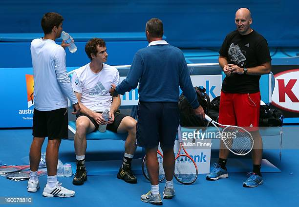 Andy Murray of Great Britain talks to his coach Ivan Lendl with Daniel Vallverdu and Jez Green in a practice session during day thirteen of the 2013...