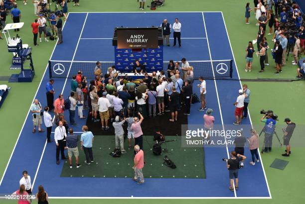 Andy Murray of Great Britain talks to the press during the US Open media availability on August 24 in the new Louis Armstrong Stadium at the USTA...
