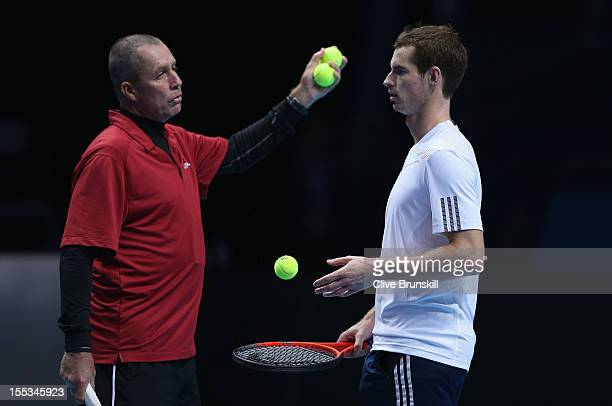 Andy Murray of Great Britain talks with his coach Ivan Lendl during a practice session prior to the start of ATP World Tour Finals Tennis at the O2...