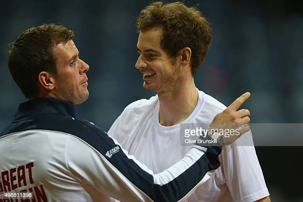 Andy Murray of Great Britain talks with his team captain Leon Smith during a practice session ahead of the start of the Davis Cup Final at Flanders...
