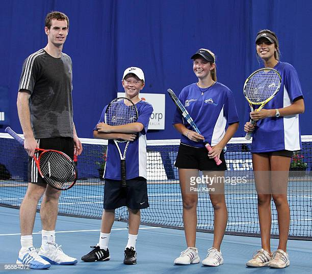Andy Murray of Great Britain talks with Jack Lyttle, Storm Sanders and Teiwa Casey after a junior clinic with three up and coming Australian junior...