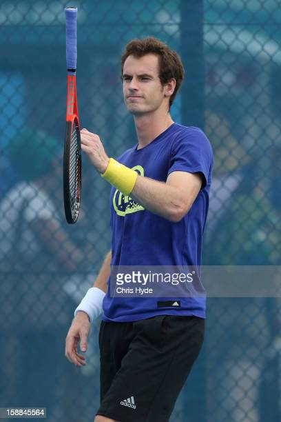Andy Murray of Great Britain throws his racket during a practice session on day three of the Brisbane International at Pat Rafter Arena on January 1,...