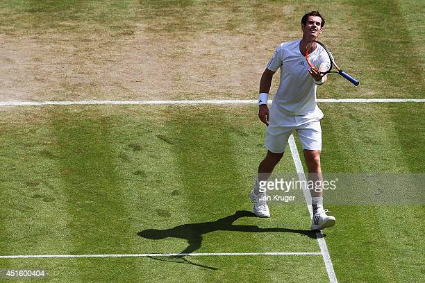 Andy Murray of Great Britain throws his racquet as he show his frustrations during his Gentlemen's Singles quarterfinal match against Grigor Dimitrov...