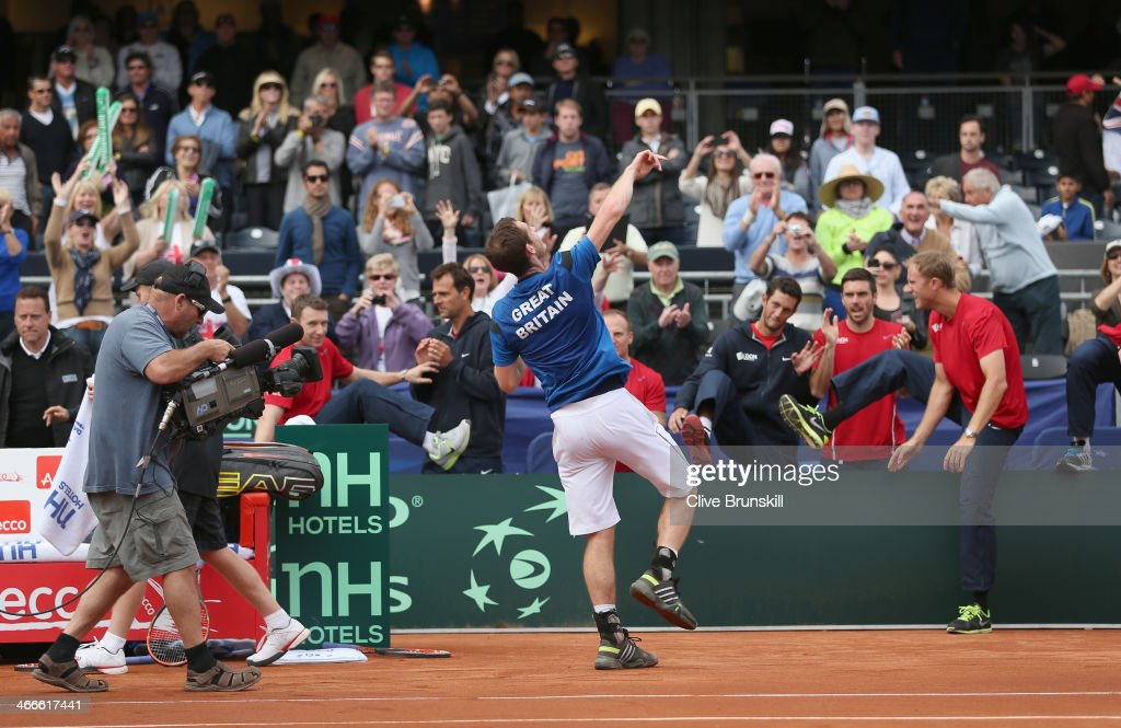 Andy Murray of Great Britain throws his wrist bands to the crowd after his four set victory against Sam Querrey of the United States during day three of the Davis Cup World Group first round between the U.S. and Great Britain at PETCO Park on February 2, 2014 in San Diego, California.
