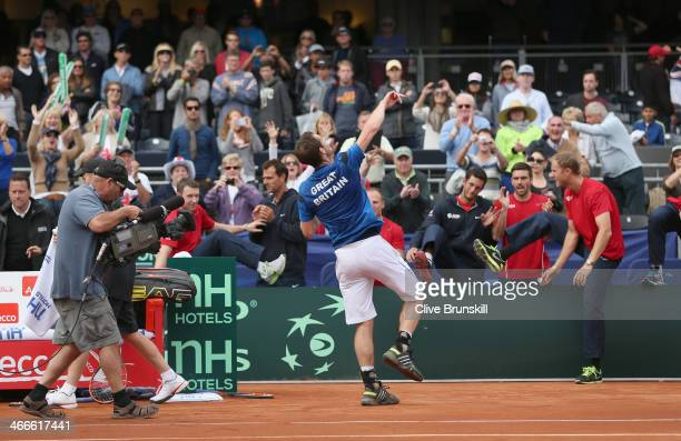 Andy Murray of Great Britain throws his wrist bands to the crowd after his four set victory against Sam Querrey of the United States during day three...