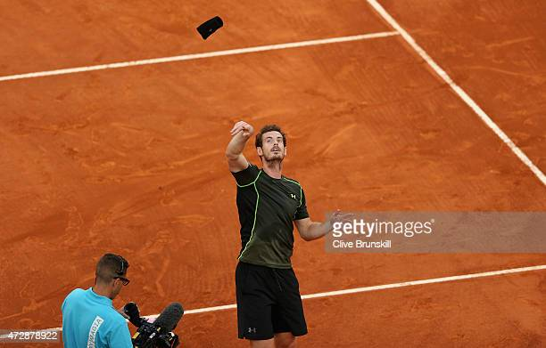 Andy Murray of Great Britain throws his wristband to the crowd his straight sets victory against Rafael Nadal of Spain in the mens final during day...