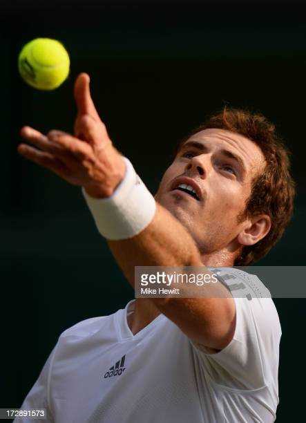 Andy Murray of Great Britain tosses the ball in the air as he serves during the Gentlemen's Singles semi-final match against Jerzy Janowicz of Poland...