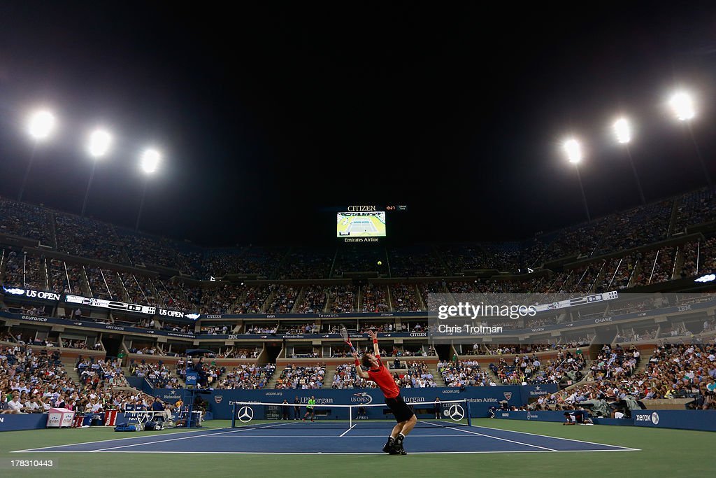 Andy Murray of Great Britain tosses the ball in the air to serve during his men's singles first round match against Michael Llodra of France on Day Three of the 2013 US Open at the USTA Billie Jean King National Tennis Center on August 28, 2013 in New York City.