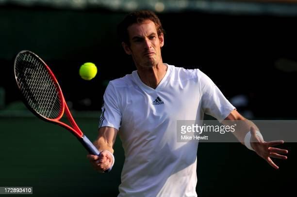 Andy Murray of Great Britain volleys during the Gentlemen's Singles semi-final match against Jerzy Janowicz of Poland on day eleven of the Wimbledon...