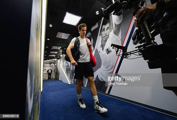 Andy Murray of Great Britain walks down the player hallway to the court before playing against Kei Nishikori of Japan during their Men's Singles...