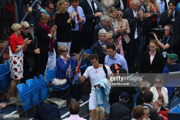 Andy Murray of Great Britain walks off the court after being defeated by Nicolas Mahut of France in his mens singles second round match on day three...