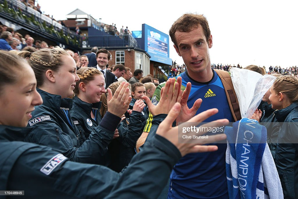 Andy Murray of Great Britain walks off the court past ballgirls after victory during the Men's Singles third round match against Marinko Matosevic of Australia on day four of the AEGON Championships at Queens Club on June 13, 2013 in London, England.