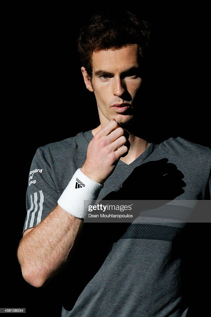 Andy Murray of Great Britain walks out to play against Grigor Dimitrov of Bulgaria during day 4 of the BNP Paribas Masters held at the at Palais Omnisports de Bercy on October 30, 2014 in Paris, France.
