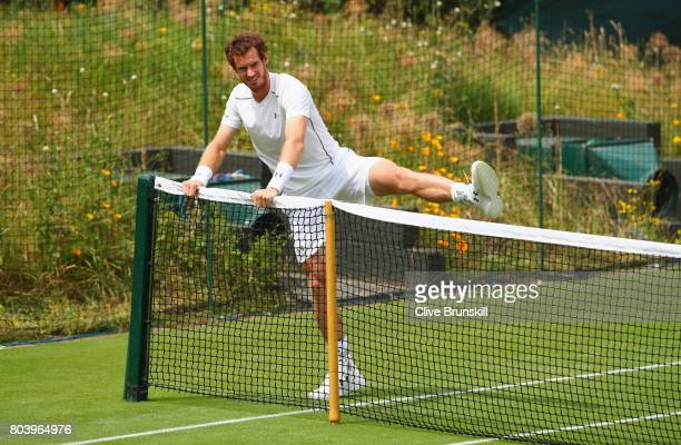 Andy Murray of Great Britain warms up during practice ahead of Wimbledon Lawn Tennis Championships at the All England Lawn Tennis and Croquet Club on...