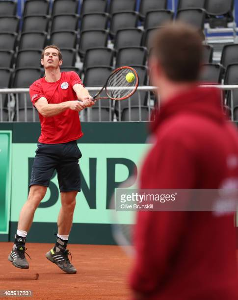 Andy Murray of Great Britain watched by captain Leon Smith practices before his first round match against the United States prior to the Davis Cup...