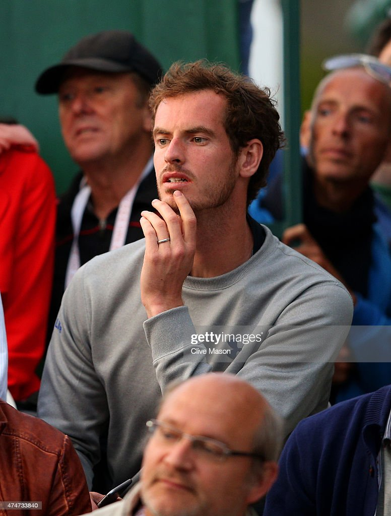 Andy Murray of Great Britain watches Kyle Edmund of Great Britain during his men's singles match against Stephane Robert of France on day two of the 2015 French Open at Roland Garros on May 25, 2015 in Paris, France.