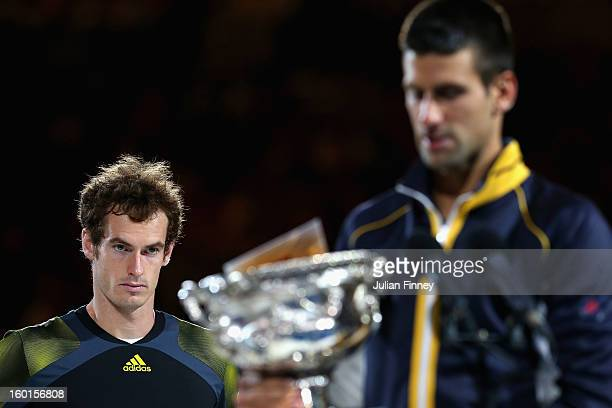 Andy Murray of Great Britain watches Novak Djokovic of Serbia hold the Norman Brookes Challenge Cup after Djokovic won their men's final match during...
