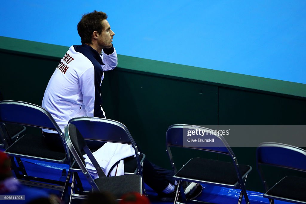 Andy Murray of Great Britain watches team-mate Kyle Edmund of Great Britain during his singles match against Guido Pella of Argentina during day one of the Davis Cup Semi Final between Great Britain and Argentina at Emirates Arena on September 16, 2016 in Glasgow, Scotland.