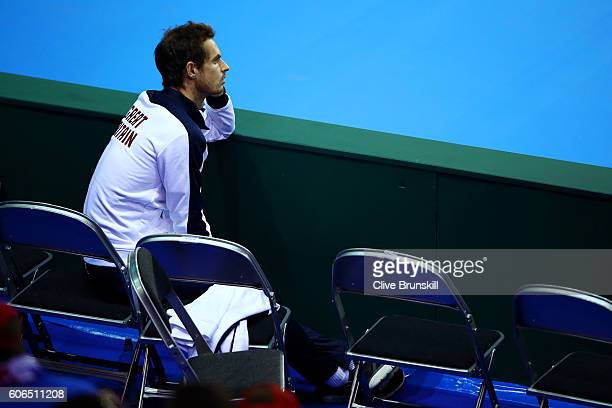 Andy Murray of Great Britain watches team-mate Kyle Edmund of Great Britain during his singles match against Guido Pella of Argentina during day one...