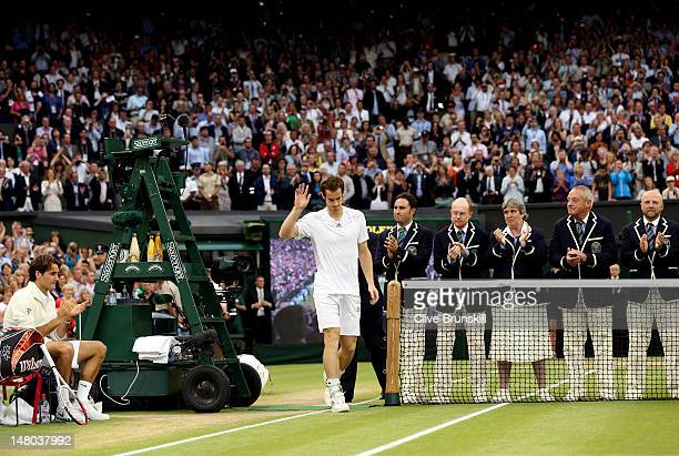Andy Murray of Great Britain waves to the crowd after being defeated in his Gentlemen's Singles final match against Roger Federer of Switzerland on...