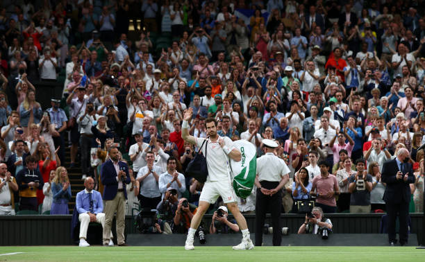 Andy Murray of Great Britain waves to the crowd after losing his men's singles third round match against Denis Shapovalov of Canada during Day Five...
