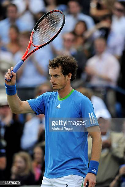 Andy Murray of Great Britain waves to the crowd after winning his Men's Singles semi final match against Andy Roddick of the United States on day six...