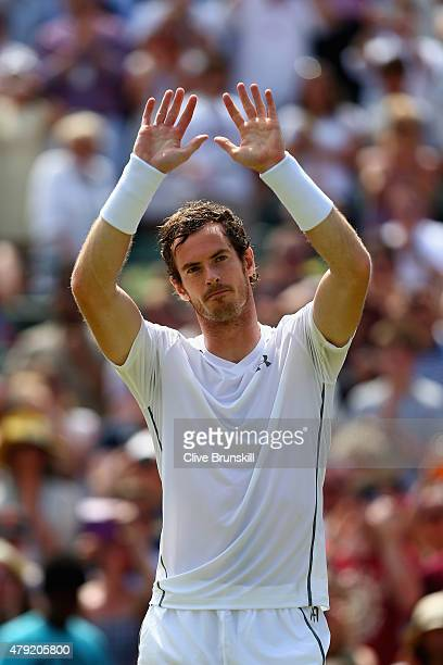 Andy Murray of Great Britain waves to the crowd after winning his Gentlemen's Singles second round match against Robin Haase of Netherlands during...