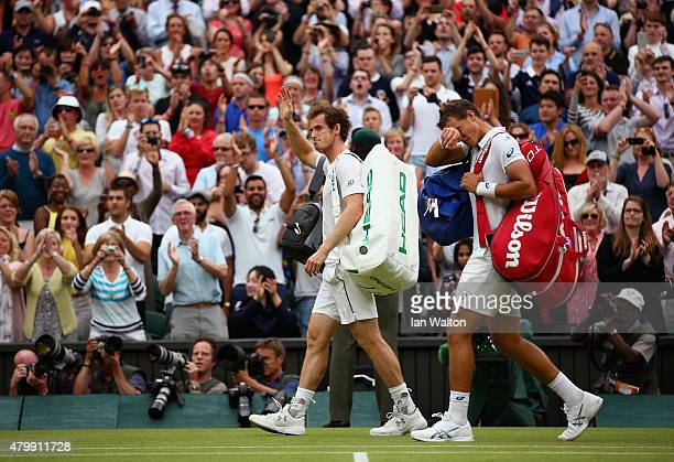Andy Murray of Great Britain waves to the crowd after winning his Gentlemens Singles Quarter Final match against Vasek Pospisil of Canada during day...