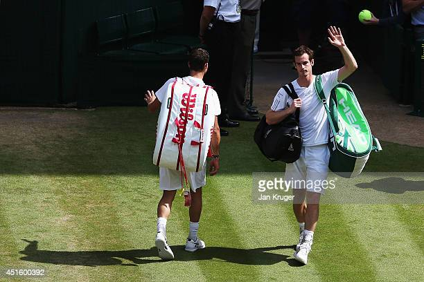 Andy Murray of Great Britain waves to the fans as he walks of court after his Gentlemen's Singles quarterfinal match against Grigor Dimitrov of...