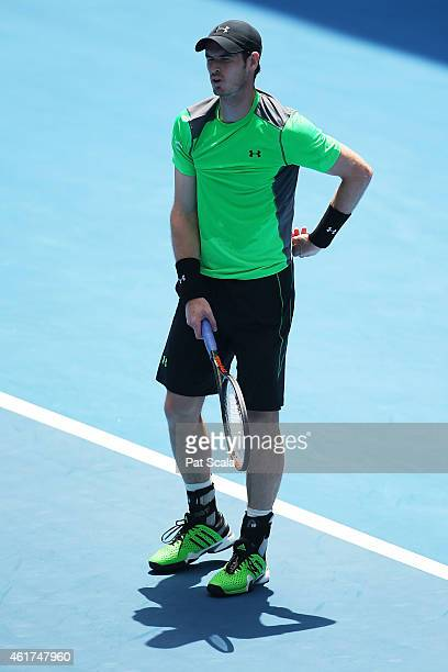 Andy Murray of Great Britain winces after a serve in his first round match against Yuki Bhambri of India during day one of the 2015 Australian Open...